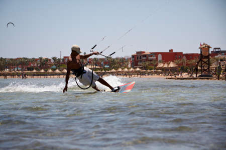 Unidentified man kitesurfing in Red Sea waters in Egypt, Sharm-El-Sheikh on April 24, 2010