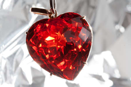 Red presious stone pendant in heart shape photo
