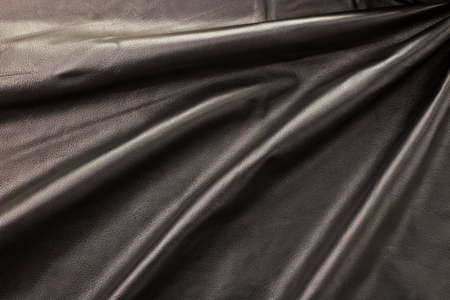 natural shiny black folded leather horizontal background Stock Photo - 9800684
