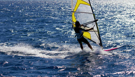 Unidentified man windsurfing in Red Sea waters in Egypt, Safaga, on October 2011 photo