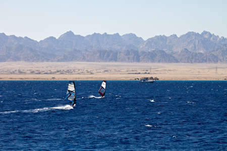 Unidentified men windsurfing in Red Sea waters in Egypt, Safaga, on October 2011 photo
