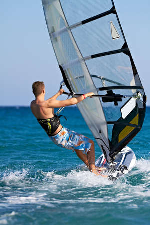 Side view of a windsurfer passing by Stock Photo