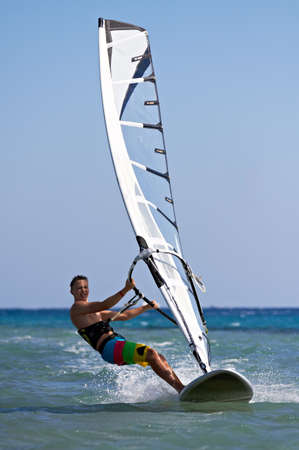 Front view of a windsurfer passing by photo