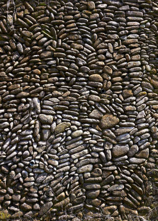 Pebble pavement closeup for vertical design background photo