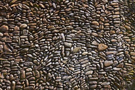 Pebble pavement closeup for horisontal design background photo