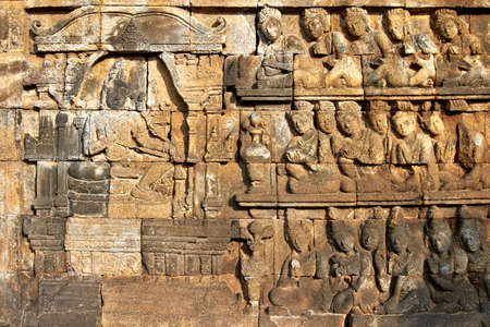 Bass-relief on the wall in Borobudur Buddhist temple, Indonesia, Java photo