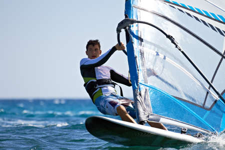 Front view of young windsurfer passing by close-up Stock Photo