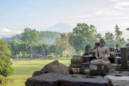 View on Merapi volcano from Borobudur temple, Java island, Indonesia photo