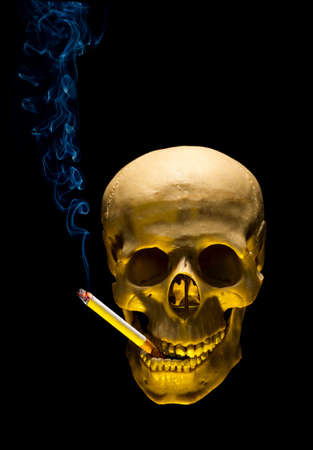 Human skull with cigarette in tooth as symbol of smoking danger