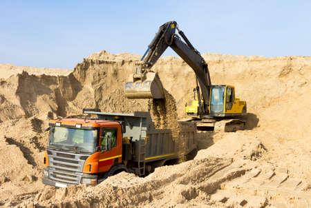 Excavator Loading Dumper Truck Construction Site