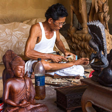A man is making wooden crafts  in Indonesia photo