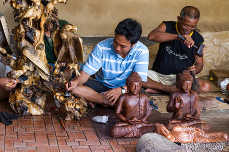 Men are making wooden crafts in Indonesia photo