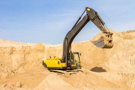 front end: Working Yellow Excavator at Construction Site