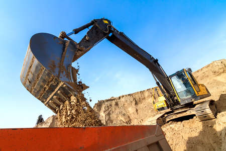 Excavator Loading Dumper Truck at Construction Site Stock Photo - 20922301