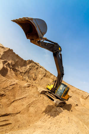 Excavator Loading Dumper Truck extreme wide-angle photo