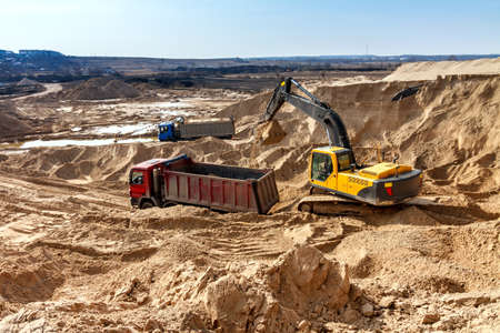 Excavator Loading Dumper Truck at Construction Site Stock Photo - 20922321