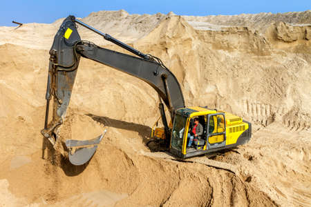 Yellow Excavator work at Construction Site photo