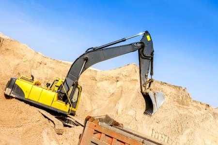 Excavator Loading Dumper Truck at Construction Site Stock Photo - 20922336