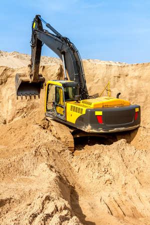 earth handful: Yellow Excavator work at Construction Site