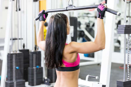 young women do a workout at the gym looks forward Standard-Bild