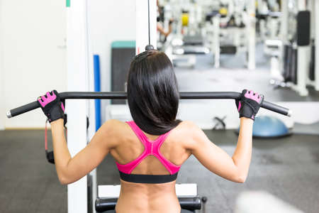 Young women do a workout at the gym Stock Photo