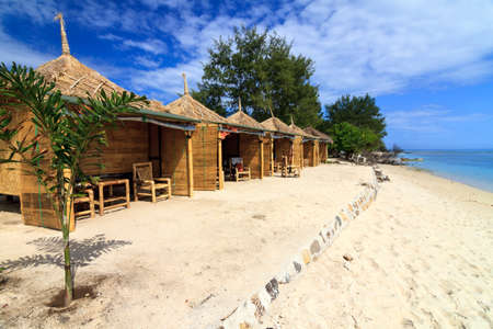 Tropical beach bungalow on ocean shore, Gili Meno, Lombok, Indonesia photo