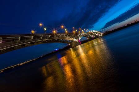 oka: Bridge at a quiet night in Nizhny Novgorod with blurred reflections