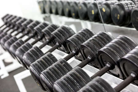 weight room: Stand with dumbbells. Sports and fitness room. Weight Training Equipment