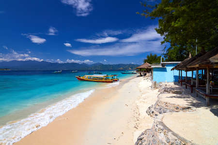 Local Traditional boat and bungalow  Gili Meno, Lombok, Indonesia Stock Photo
