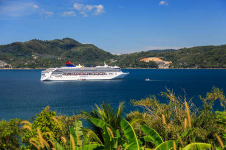 luxury white cruise ship with calm seas and blue sky photo