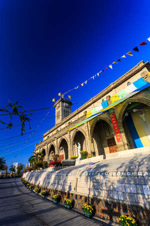 evening church: King Cathedral (Sstone Church) in the evening. Nha Trang, Vietnam. Vertical orientation
