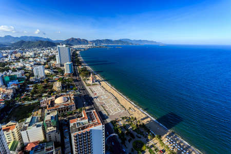 Aerial view over Nha Trang city, Vietnam taken from rooftop, extreme wide angle Stock Photo