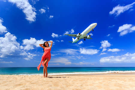 airplane landing: Girl on the beach and airplane landing. Phuket, Thailand