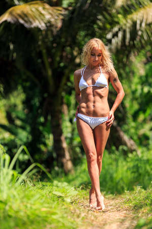 young girls nature: Young beautiful woman walking in the tropical nature