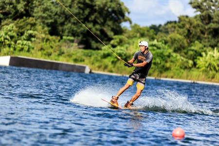 shifted: Man Wakeboarding in action. Phuket, Thailand. shifted horizon Stock Photo