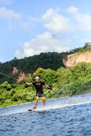 wakeboarding: Man Wakeboarding in action. Phuket, Thailand. shifted horizon Stock Photo