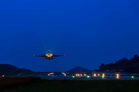 aerospace industry: Passenger Airplane take off from runways at night