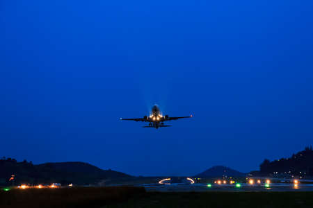 runways: Passenger Airplane take off from runways at night