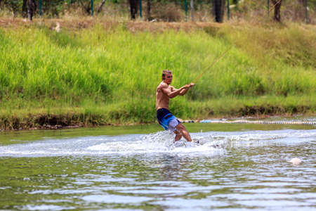 wakeboarding: Man Wakeboarding in action. Phuket, Thailand
