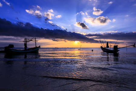 Dramatic Sunset with silhuette local boat in Thailand