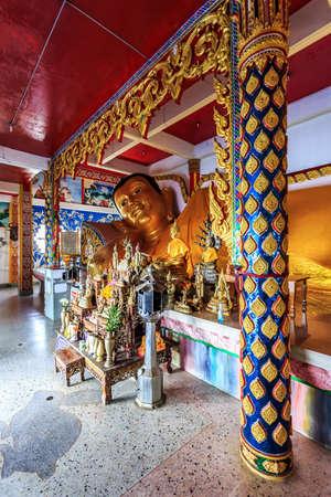Big Reclining golen Buddha statue in Wat Koh Sirey. Phuket, Thailand