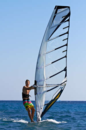 water wave: Front view of a windsurfer passing by
