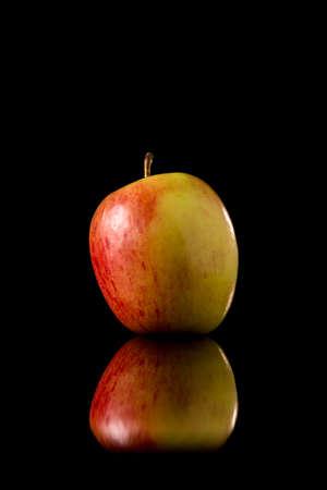 reflective: Fresh red apple on a black reflective background, Studio shot,