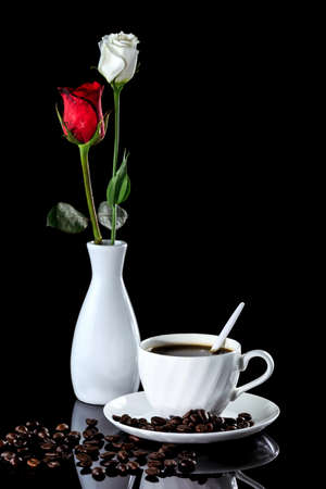 Composition of coffee, white and red rose on a black reflective background. Studio shot