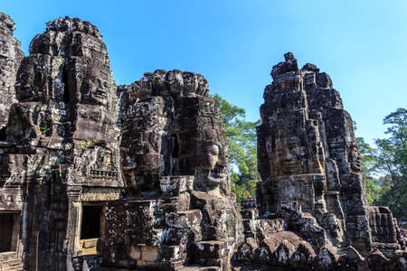 Giant stone faces of ancient buddhist khmer Bayon temple in Angkor Thom, Siem Reap, Cambodia