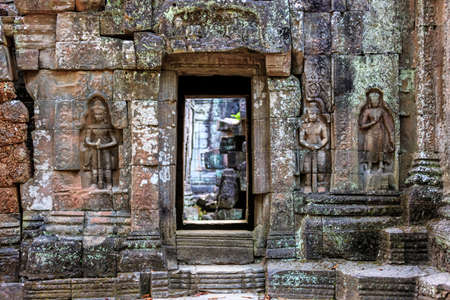 Ancient stone door in ruins of  buddhist khmer temple near Siem Reap, Cambodia