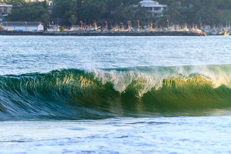 Ocean wave at the beach. Evening. Tangalle, Sri Lanka