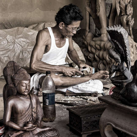 A man is making wooden crafts. Bali. Ububd. Indonesia Stock Photo