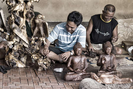 Men are making wooden crafts. Bali. Ububd. Indonesia Stock Photo