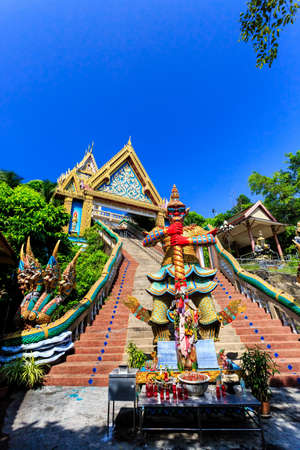 The main stairs leading to Wat Khao Rang temple with boards description of gods and monsters. Phuket. Thailand
